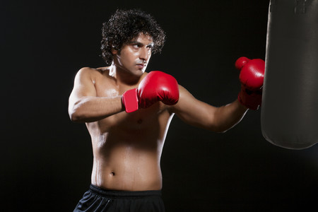 aggressiveness: Boxer punching the bag