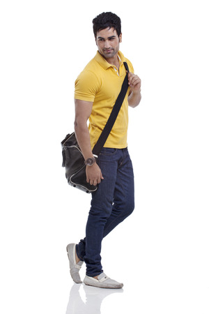 duffel: Smiling young man with duffel bag over white background
