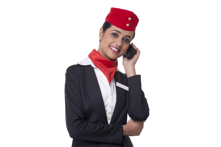 Portrait of happy young airhostess on call isolated over white background