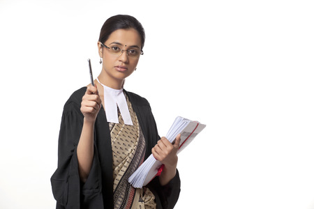 proceedings: Portrait of young female lawyer holding pen and documents isolated over white background Stock Photo