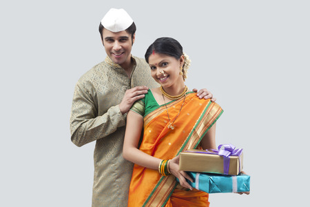 sutra: Portrait of Maharashtrian couple holding gifts