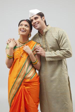 nose ring: Maharashtrian couple looking at something