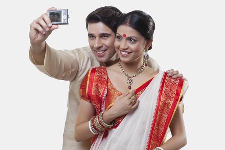 kurta: Bengali couple taking a self portrait