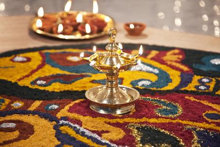 Close-up of rangoli with diyas