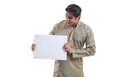 kurta: Bengali man holding a white placard Stock Photo