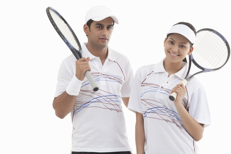 Portrait of man and woman holding rackets isolated over white background