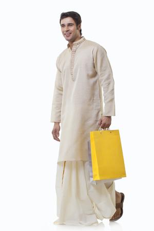 dhoti: Bengali man holding shopping bags