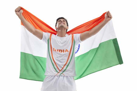 Happy male hockey player celebrating victory with Indian flag isolated over white background