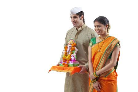 maharashtra: Maharashtrian couple with a Ganesh idol