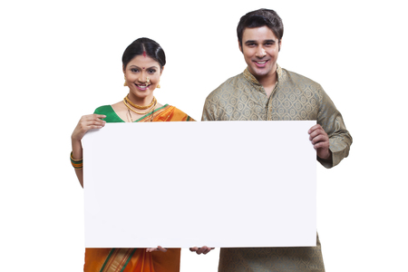 Portrait of Maharashtrian couple holding a placard