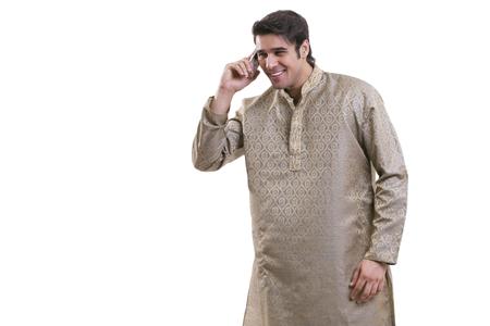 kurta: Bengali man talking on a mobile phone
