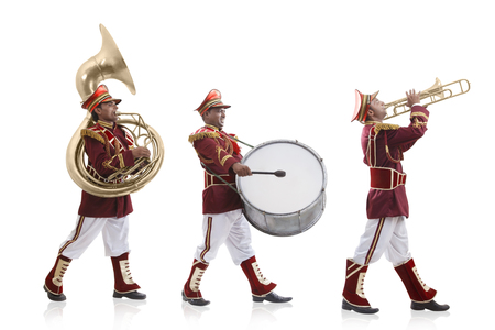 Bandwalas with instruments marching