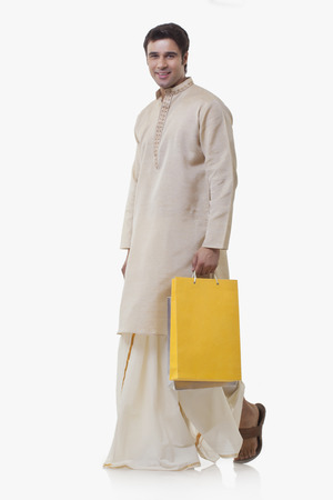west bengal: Portrait of a Bengali man holding shopping bags