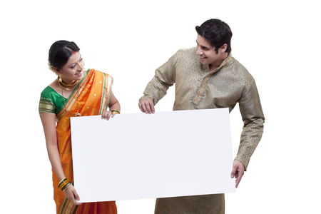 ring stand: Maharashtrian couple holding a placard Stock Photo