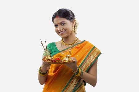 Portrait of a Maharashtrian woman holding a puja thali