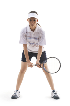 Portrait of young woman holding tennis racket isolated over white background
