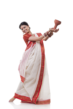 Portrait of Bengali woman doing Dhunuchi dance
