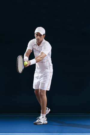 Full length of male tennis player preparing to serve Stock Photo