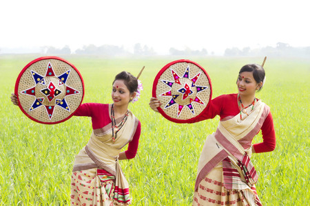 Bihu women holding jaapis Stock Photo