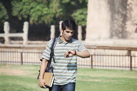 Student checking his watch Stock Photo