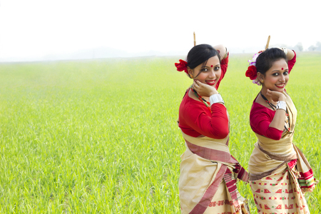 Portrait of women doing Bihu dance