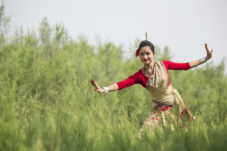 Woman performing Bihu dance