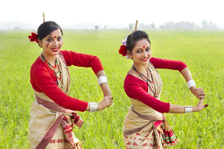 Portrait of women doing Bihu dance