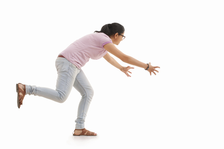 Young woman trying to catch