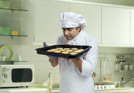 30 35 years: Chef smelling freshly baked cookies