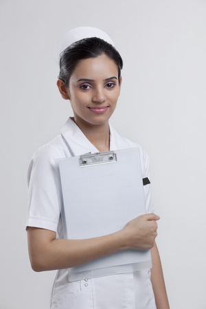 Portrait of a nurse with a clipboard Stock Photo