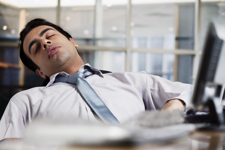 Businessman sleeping in the office Stock Photo