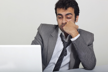 Businessman feeling sleepy at work