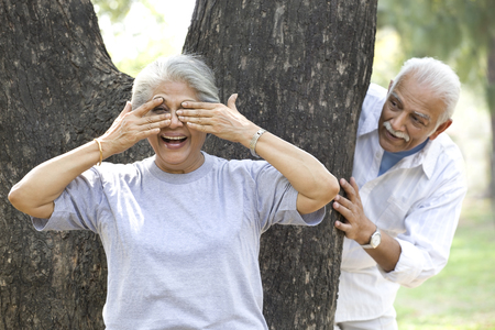 Old couple playing hide and seek