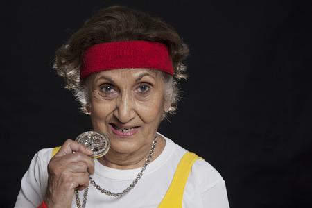 Trendy senior woman holding locket Stock Photo