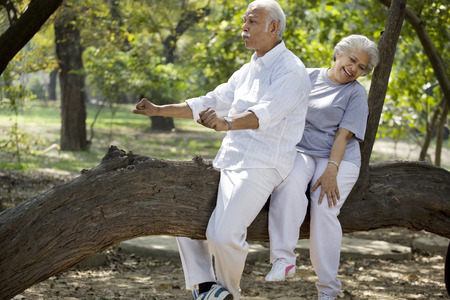 Playful senior man enjoying with woman at park Stock Photo - 80389107