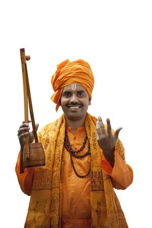 Portrait of a minstrel holding an ektara Stock Photo