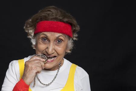 Close-up of senior woman biting locket Stock Photo
