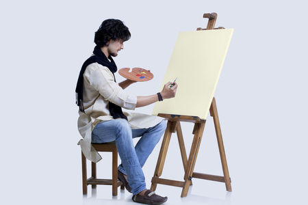 kurta: Young male artist about to paint against colored background