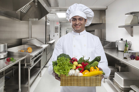 eating utensils: Chef carrying a basket of fresh vegetables