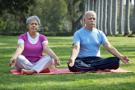 Couple at park meditating