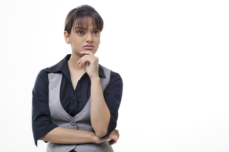 welldressed: Thoughtful businesswoman over white background Stock Photo
