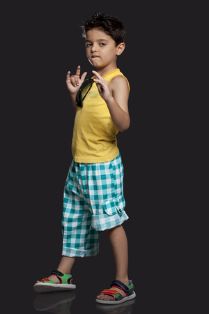 roll out: Boy with attitude over black background