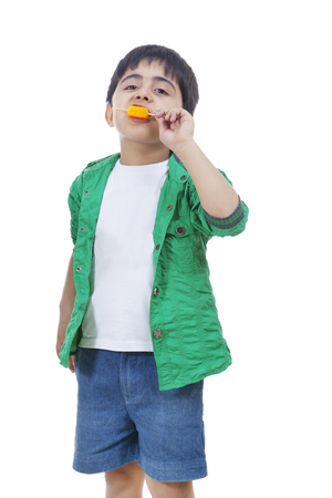 flavored: Boy eating ice lolly