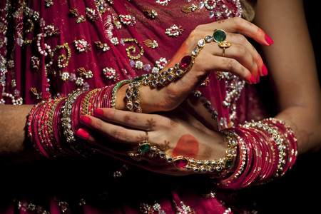 Close-up of jewelery on hands of Indian bride Stock Photo