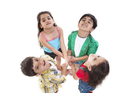 Portrait of little children holding hands