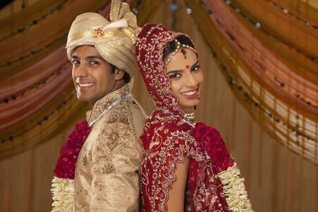 Portrait of newly married Indian couple Stock Photo