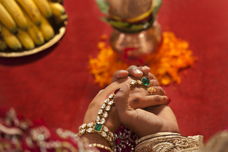 Close-up of groom holding brides hand