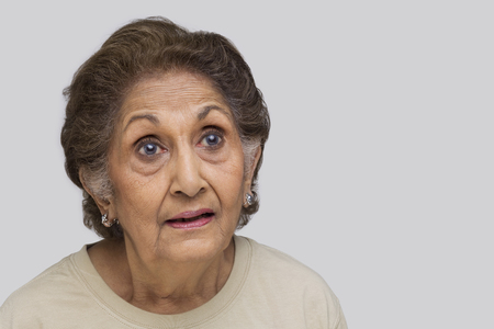 Close-up of surprised senior woman