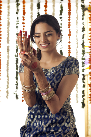 bride bangle: Indian bride wearing bangles