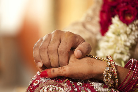 Close-up of groom holding brides hand Stock Photo - 80389452